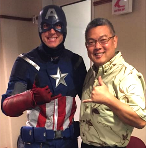 Rep. Mark Takai helps Captain America (University of Hawaii Men's Basketball Assistant Coach Jamie Smith) get ready for an interview with KITV in January.