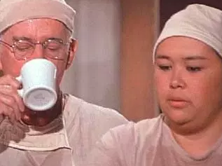 Kellye Nakahara Wallett as Nurse Kellye in the OR with Col. Potter (Harry Morgan).