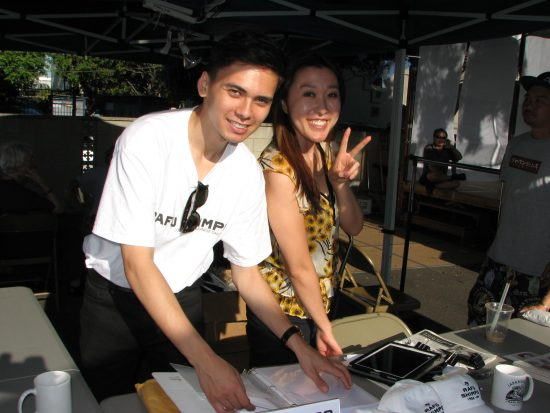 Matthew Ormseth and Rafu   Japanese section reporter Junko Yoshida staffing the Rafu booth at Nishi Hongwanji's Obon Festival on July 10. (J.K. YAMAMOTO/Rafu Shimpo)