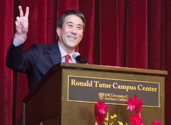 FIGHT ON: Rod Nakamoto gives the traditional USC victory sign as he is installed at the president of USC Alumni Association Board of Governors on May 26.