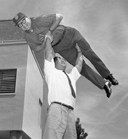 Tommy Kono shows his strength by lifting a grown man over his head on May 18, 1963. (Courtesy Center for Sacramento History, Sacramento Bee Archive)