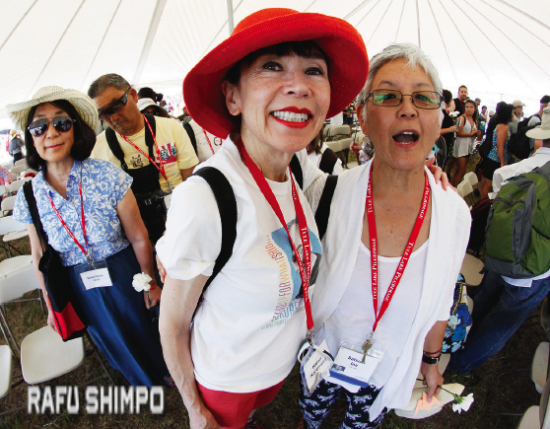 """Karen Korematsu, daughter of Fred Korematsu, and filmmaker Dr. Satsuki Ina (""""Children of the Camps"""") take a moment to say hello and pose for a picture at the end of the Tule Lake memorial service. (MARIO G. REYES/Rafu Shimpo)"""