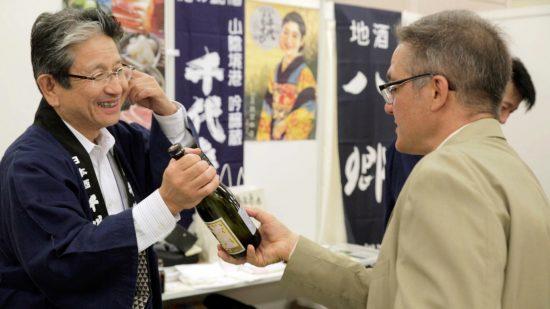"American ""sake evangelist"" John Gauntner (right) at a sake fair in Japan. ( © 2015 Wagamama Media LLC)"