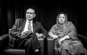 Khizr Khan, holding a pocket constitution, and his wife Ghazala Khan somberly sit backstage before speaking on the last night of the Democratic National Convention. Photo by Erin Schaff/DNCC