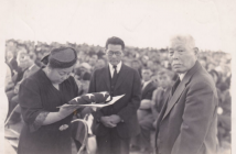"Tom Ikeda's grandparents Fred Suyekichi and Akino Kinoshita (left and center) receive a flag in honor of their son Staff Sergeant Francis ""Bako"" Kinoshita, killed in action in World War II, accompanied by a family friend. (Photo courtesy Tom Ikeda)"