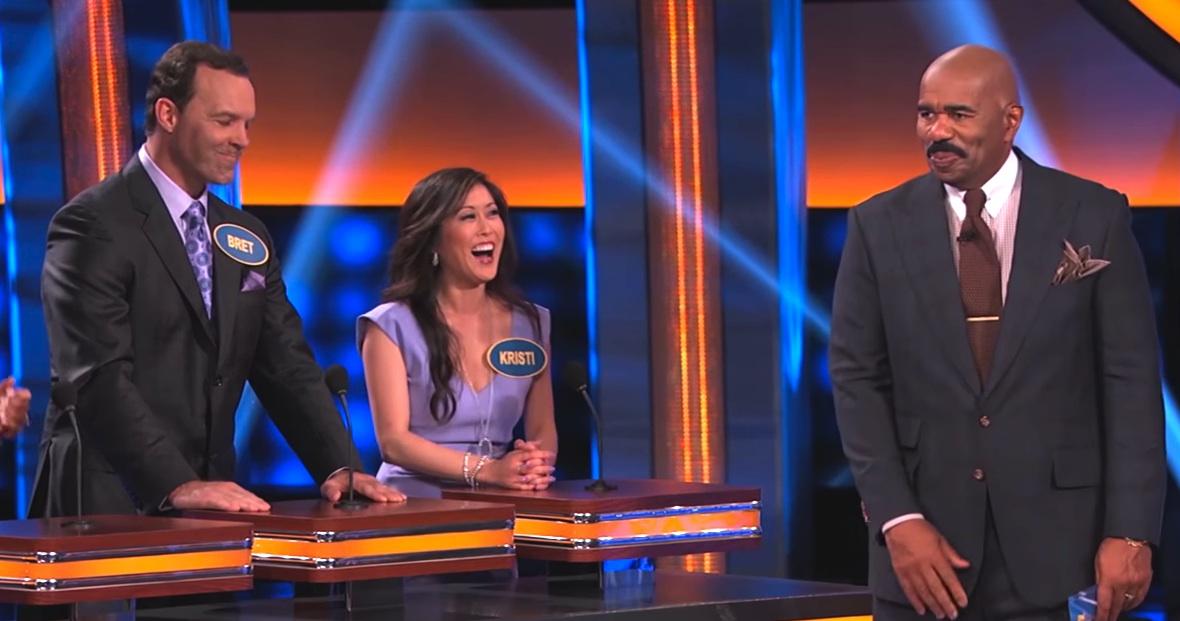 "Bret Hedican, Kristi Yamaguchi and host Steve Harvey on ""Celebrity Family Feud."""