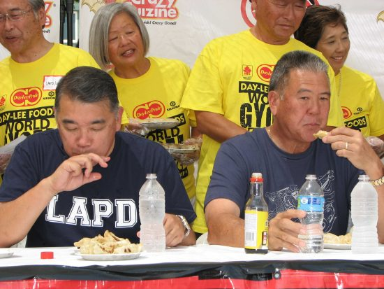 Members of the Los Angeles Police Department, including Terry Hara (left), and the Los Angeles Fire Department, including David Yamahata (right), faced off last year prior to the main event. (J.K. YAMAMOTO/Rafu Shimpo)