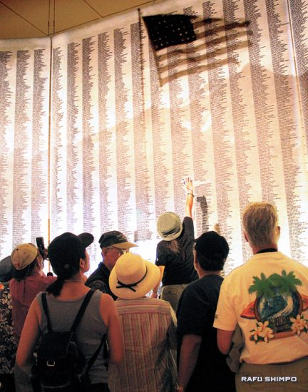 Visitors to the Manzanar Interpretive Center point to a listing of the names at the center's grand opening in 2004. The public's help is sought to update the roster of names. (MARIO G. REYES/Rafu Shimpo)