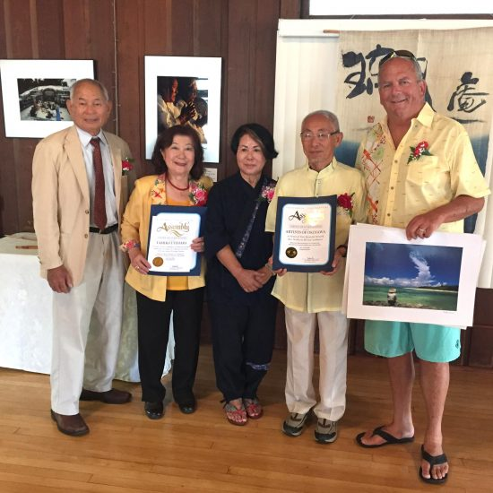 From left: OAA President Shingi Kuniyoshi, Uchinanchu Goodwill Ambassador Tamiko Uyehara, artist Yoshiko Grace Nishihira, photographer Shokyu Otsuka, and Redondo Beach Mayor Steve Aspel. The mayor is holding one of the photographs that Otsuka is donating to the City of Redondo Beach.