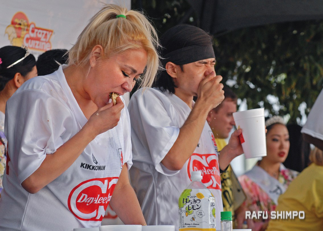 Miki Sudo, left, and Matt Stonie gobble down dumplings during the 2016 Day-Lee Foods World Gyoza Eating Championship on June 20 at the JACCC Plaza.