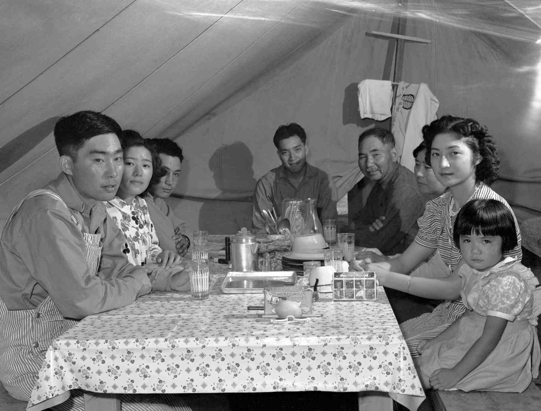 The Ouchida family at the Nyssa, Ore., farm labor camp, pictured clockwise from the lower left: Jack, Shizuko, Henry, Thomas, Kiuda, Shizuyo, Mary, and Rosie. (Library of Congress, Prints & Photographs Division, FSA-OWI Collection, LC-USF34-073354-D)