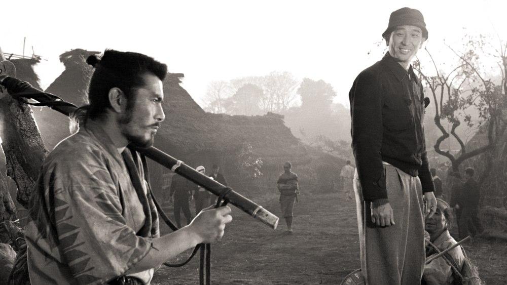 "Toshiro Mifune and director Akira Kurosawa on the set of ""Seven Samurai."""
