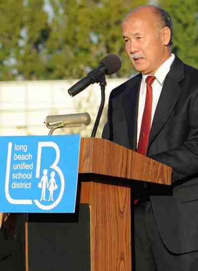 Douglas Sato spoke on his mother's behalf. (Photo by Mark Savage)