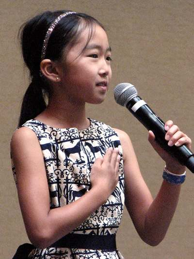 Fourth-grader Chihiro Kato led the Pledge of Allegiance.