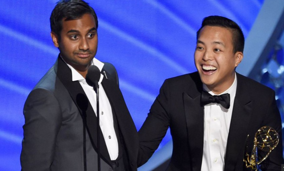 """Aziz Ansari and Paul Yang accept their Emmy for """"Master of None."""" (ABC)"""