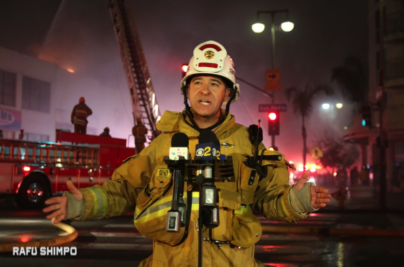 LAFD Deputy Chief Phillip Fligiel gives reporters an update (JUN NAGATA/Rafu Shimpo)