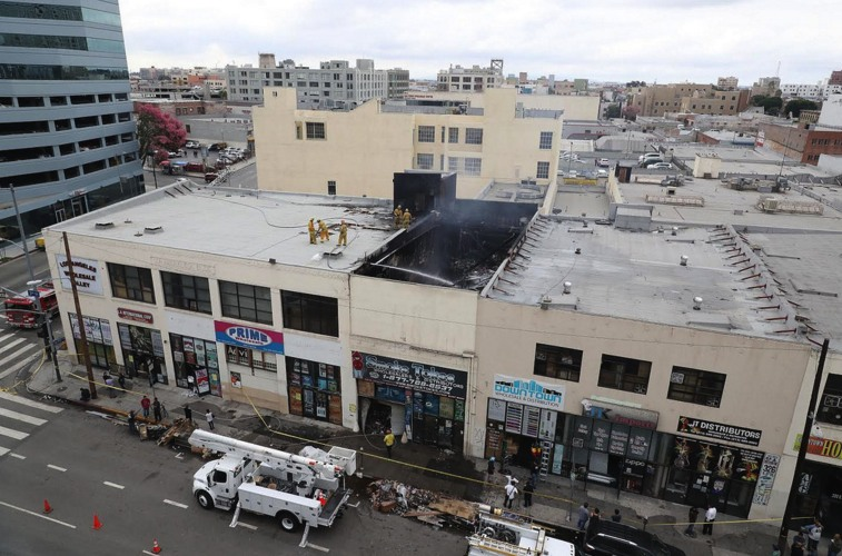 Above and below: Two views of the damaged store the next morning. (LAFD)