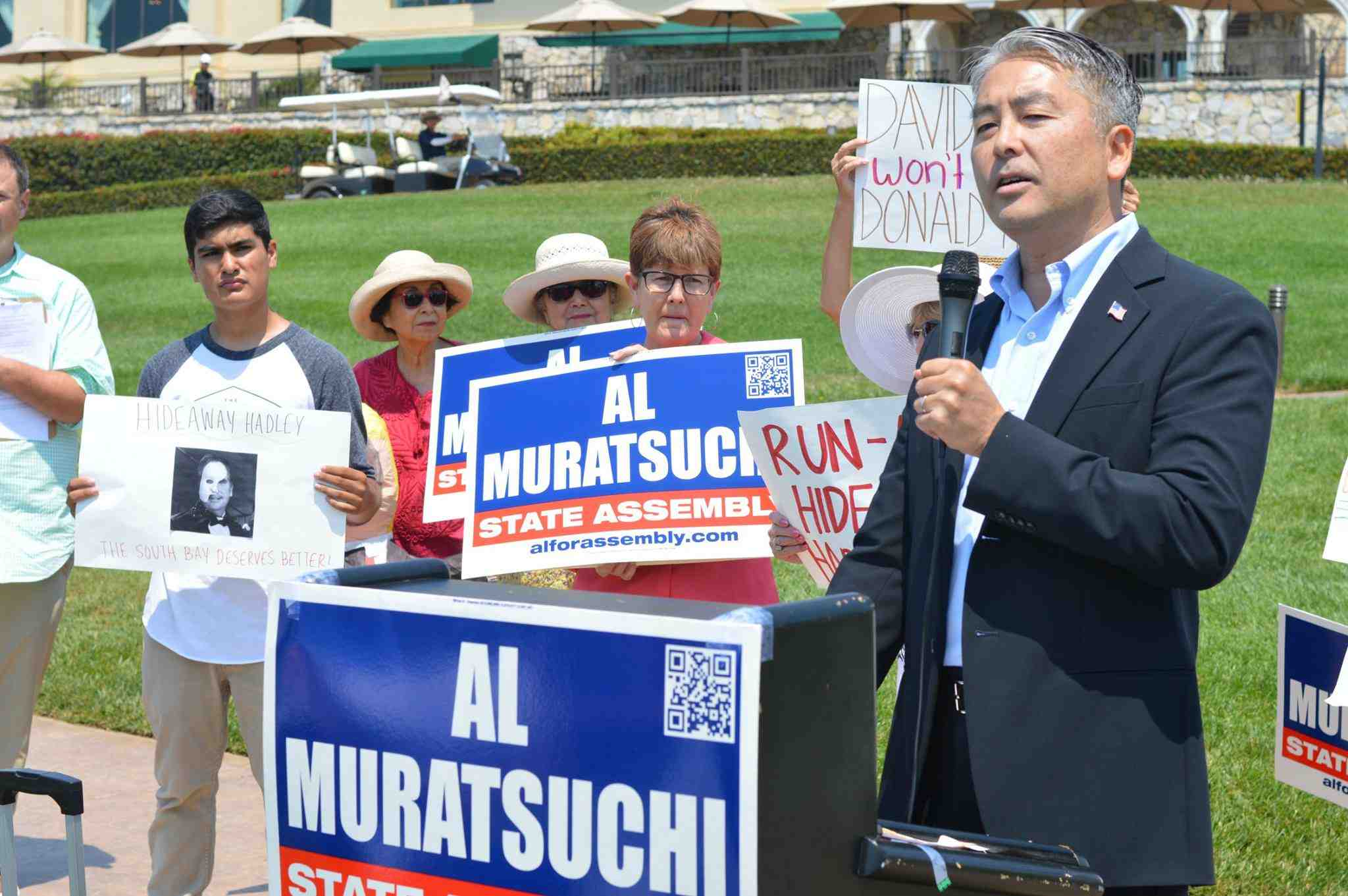 Assembly candidate Al Muratsuchi speaks at a rally in front of a Rancho Palos Verdes golf course owned by Donald Trump.