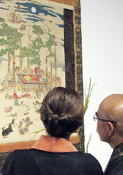 "Visitors look at ""The Death of the Buddha"" by Mori Tetsuzan."
