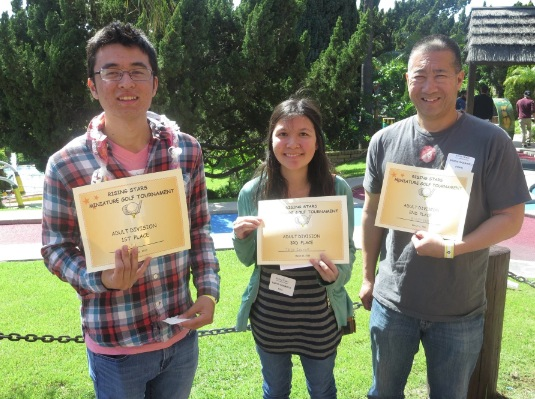 Adult winners (from left): Felix Harder, first place; Taryn Iwamoto, RS 11, third place; Brodie Sadahiro, second place.