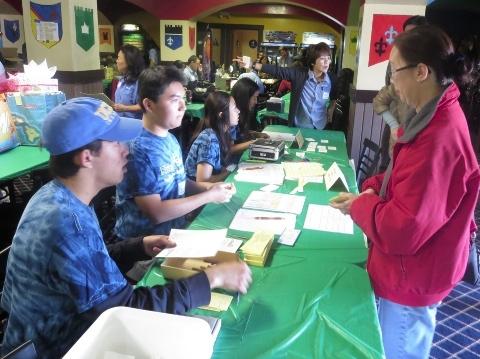 Wyatt Kurumiya, Arthur Matsushita, Jenna Yamada and Alyssa Suzukawa handle registration.