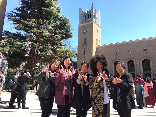"From left: Iris (Orikasa) Tomita, Arlene (Fushiki) Yee, Stephanie (Nishi) Quitugua, Gael (Brown) Pullen and Amy E. Kato making ""W"" signs celebrating their return to Waseda University last March, commemorating their 40th Anniversary (1975-76) of attending the Waseda International Division (Kokusaibu) program. (Photo courtesy of Amy Kato)"