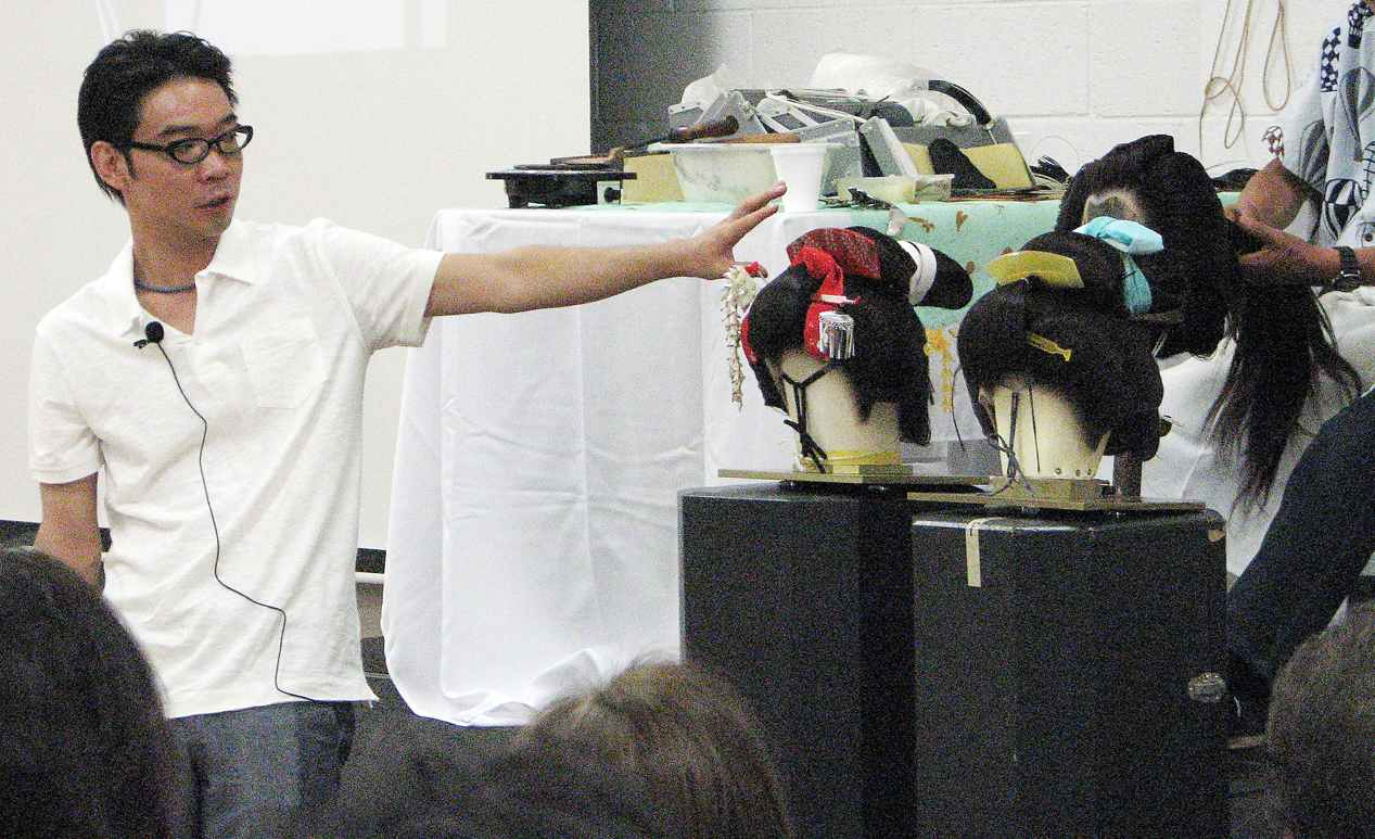 Kazuhiro Toyotani shows examples of wigs that he and his father make for kabuki and classical dance.