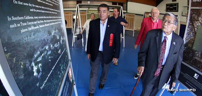 "Former Secretary of Transportation Norman Mineta (right) and Los Angeles County Supervisor Mike Antonovich are given a tour of ""Only the Oaks Remain"" by former LAPD Deputy Chief Terry Hara."