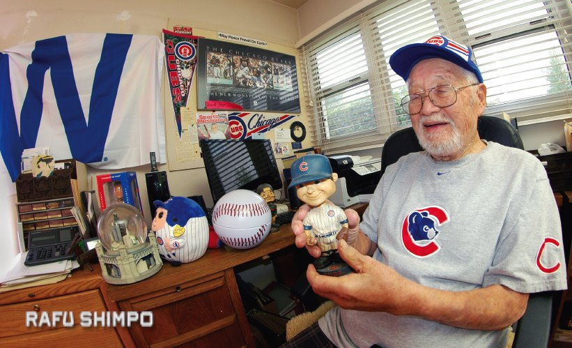 Calvin Tajima shows off a vintage Chicago Cubs bobblehead doll at his home in Altadena, where there is Cubs memorabilia in nearly every room. (MIKEY HIRANO CULROSS/Rafu Shimpo)