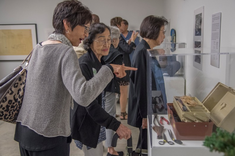 "Guests enjoy the artifacts on display at the ""Sharing Culture 