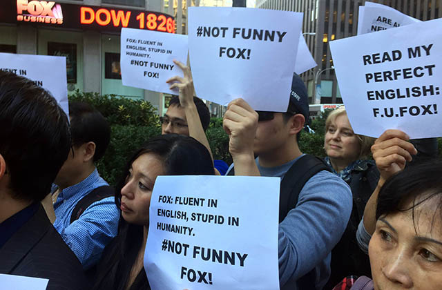 "Protestors gather outside News Corp.'s New York headquarters to protest an ""O'Reilly Factor"" segment on Chinatown residents. (Asia Society)"