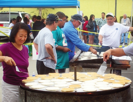 Team moms and coaches will flip more than 3,000 pancakes for the Hawaiian breakfast coming Saturday, Oct. 8, at the Southeast Japanese School and Community Center.