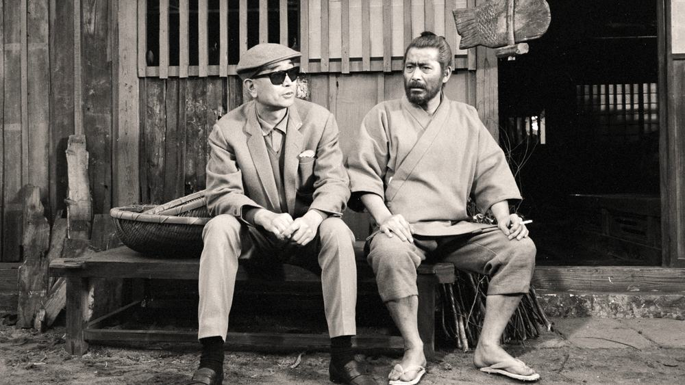 "Toshiro Mifune and director Akira Kurosawa on the set of ""Red Beard"" (1965)."