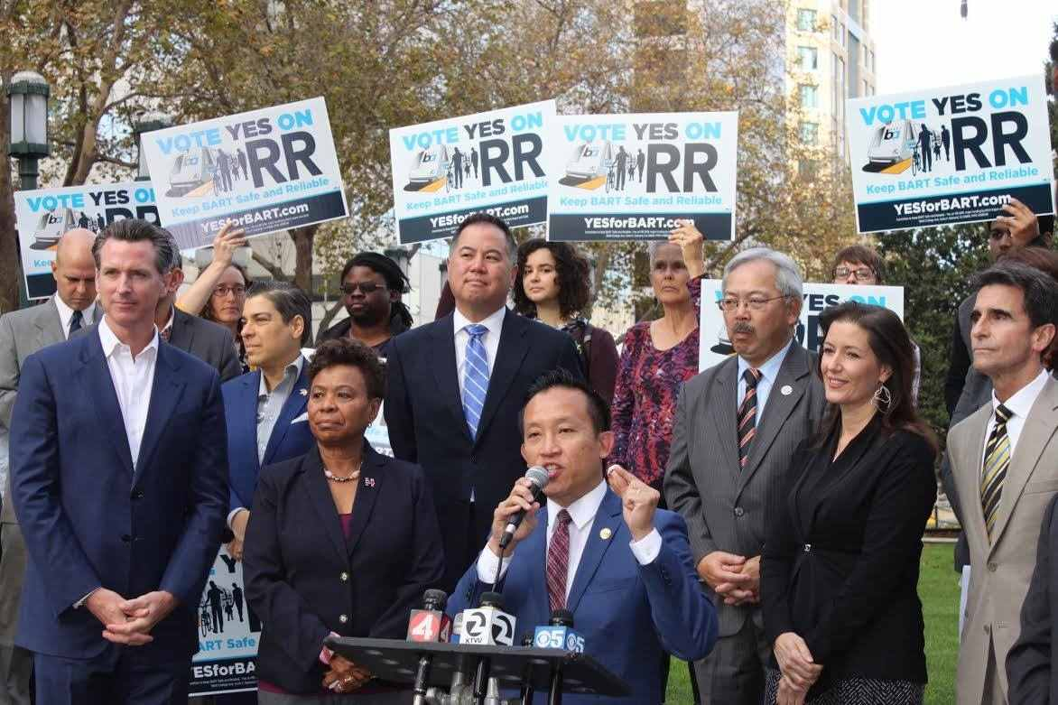 On Election Eve, Bay Area elected officials gathered in support of Measure RR, which would upgrade BART (Bay Area Rapid Transit). Front row, from left: Lt. Gov. Gavin Newsom, former mayor of San Francisco and candidate for governor in 2018; Rep. Barbara Lee (D-Oakland); Assemblymembers Phil Ting and David Chiu (D-San Francisco); San Francisco Mayor Ed Lee; Oakland Mayor Libby Schaaf; and State Sen. Mark Leno. Ting, Chiu and Rep. Lee were easily re-elected on Nov. 8; voters approved Measure RR.