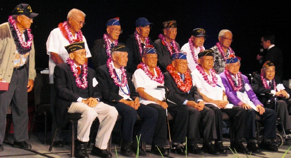 Nisei World War II veterans appeared on stage for a group photo.