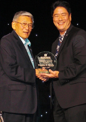 Former Secretary of Transportation Norman Mineta receives the Defining Courage Award from GFBNEC Interim CEO/President Mitch Maki.