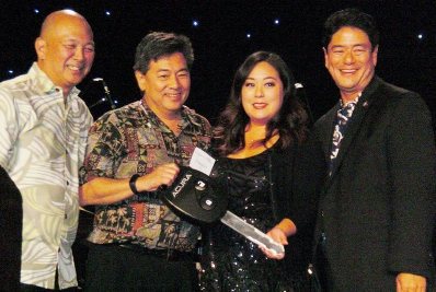 From left: GFBNEC Chairman Bill Seki, opportunity drawing winner Doug Urata, Kacey Takashima of American Honda Motor Co., GFBNEC Interim CEO/President Mitch Maki.