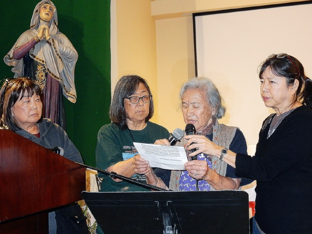 Haru Kuromiya speaks at the Dolores Mission Catholic Church in Boyle Heights on Nov. 20. She is flanked by NCRR members Carrie Morita, Kathy Masaoka and June Hibino. (Photo by Mike Murase)