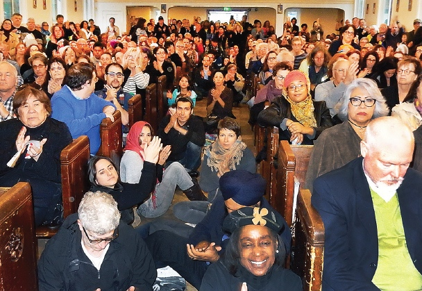 A capacity crowd filled the mission for the interfaith vigil. (Photo by Mike Murase)