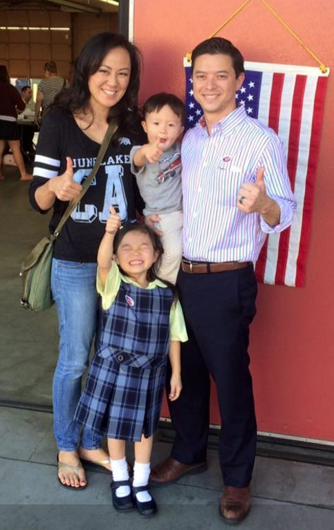 Jeff and Akiko Maloney at their polling place on Nov. 8, accompanied by their son Koji and daughter Mayumi.