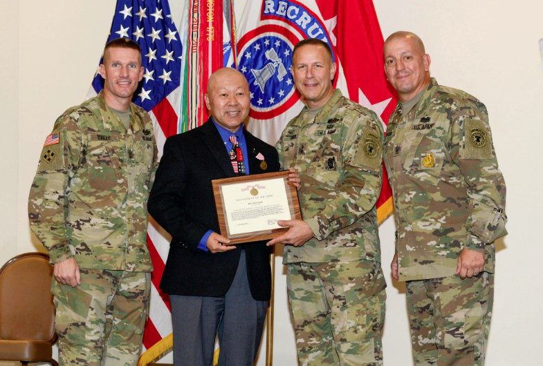 Lance Izumi was recently recognized by the U.S. Army Recruiting Command in Fort Knox, Ky. Presenting the award to Izumi (second from left) are (from left) Sergeant Major of the Army Daniel Dailey, U.S. Army Recruiting Commanding General Maj. Gen. Jeffrey Snow, and Command Sergeant Major Anthony Stoneburg.