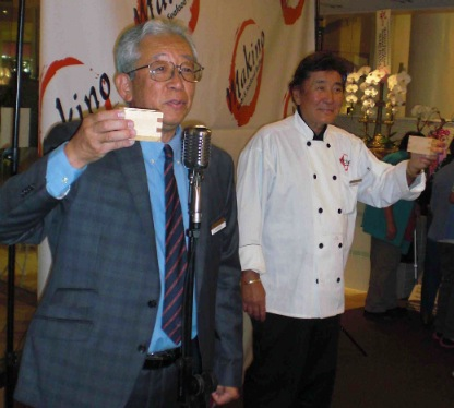 Owner Kaku Makino (right) and Controller/General Manager Nick Kuroda lead a toast after the kagami-wari ceremony.