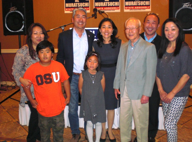 Al Muratsuchi was joined by supporters and family members as he waited for election results. From left: Mayumi Asoshina and her son; Muratsuchi with daughter Sophia, wife Hiroko an father Jiro Muratsuchi; Andy Matsumoto; Kazue Kitagaito. (J.K. YAMAMOTO/Rafu Shimpo)