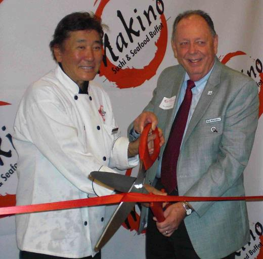 Ribbon-cutting by owner Kaku Makino and Ron Whittemore of the Industry Manufacturers Council.