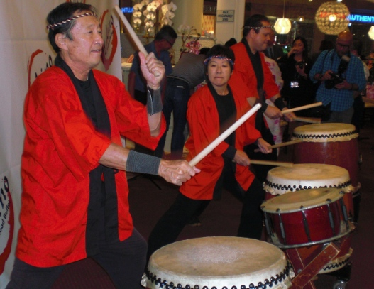 Tom Kurai (left) led a performance by Taiko Center of Los Angeles.
