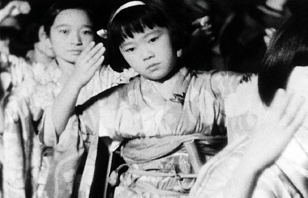 """Young dancers are shown as part of a Nisei Week ondo in a scene from """"Little Tokyo 1930s Home Movie,"""" a compilation of home movies by Akira Kawasaki. (Visual Communications Photographic Archive)"""