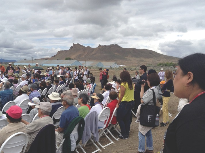 Tule Lake Pilgrimage participants with Castle Rock in the background.