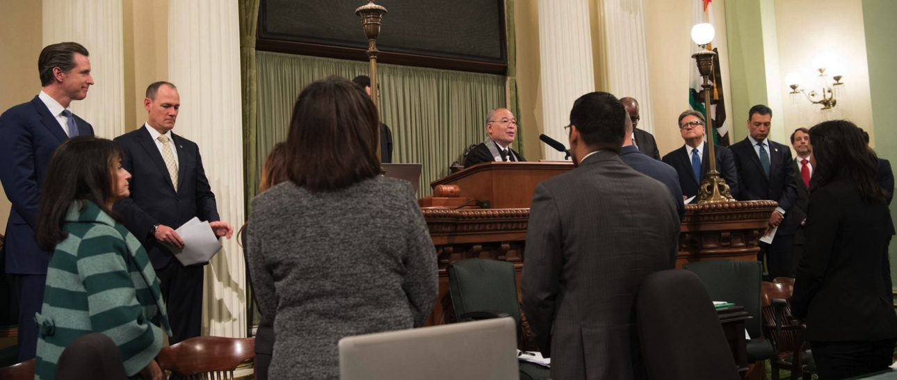Rev. Bob Oshita speaks on the Assembly floor at the State Capitol.
