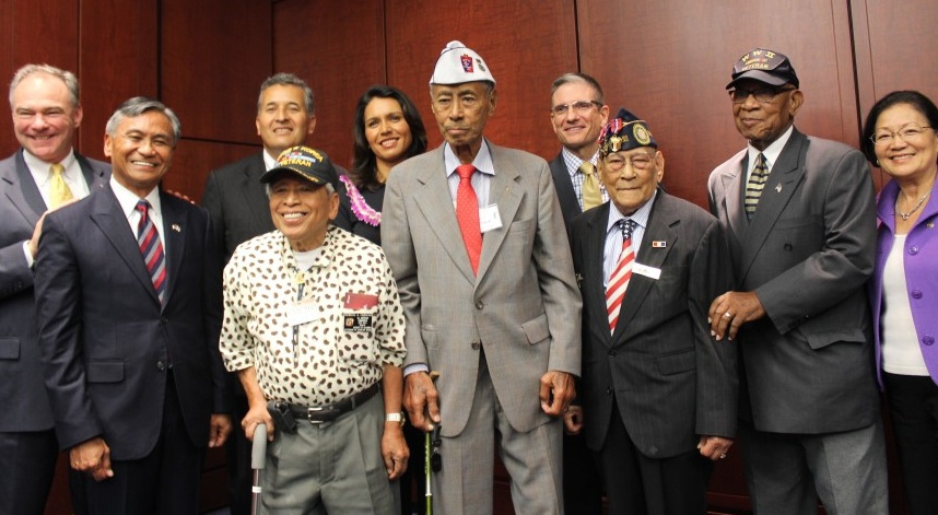 On June 11 in Washington, D.C., the Filipino Veterans Recognition and Education Project (FilVetREP) joined members of Congress to announce the introduction of a bill to award the Congressional Gold Medal to Filipino World War II veterans. Participating in the press conference were (from left) Sen. Tim Kaine (D-Va.), Maj. Gen. Antonio Taguba, Rep. Juan Vargas (D-Chula Vista), Rey Cabacar, Rep. Tulsi Gabbard (D-Hawaii), Jesse Baltazar, Rep. Joe Heck (R-Nev.), Celestino Almeda, Mr. Postel (first name not available), and Sen. Mazie Hirono (D-Hawaii). (Photo by Jon Melegrito)