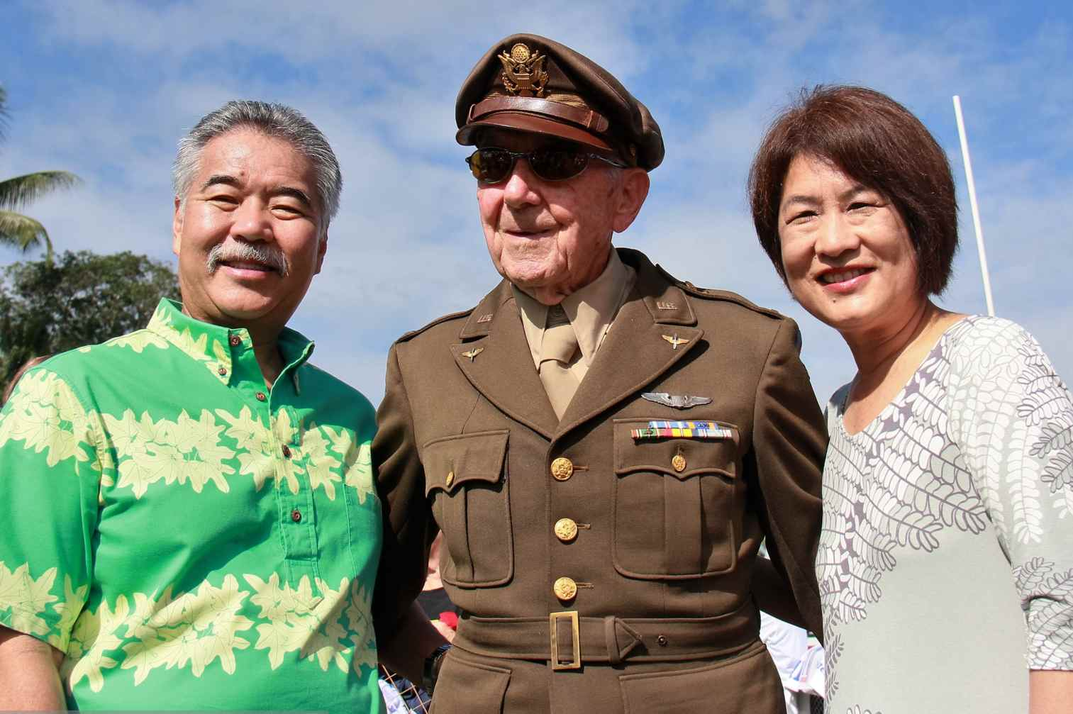 Gov. David Ige and First Lady Dawn Amano-Ige with World War II veteran Walter Hughes in Hilo.